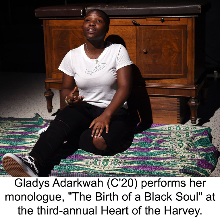 Gladys Adarkwah sits on a rug before a chest of drawers performing her monologue