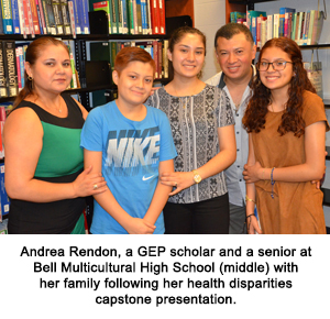 Andrea Rendon, a GEP scholar and a senior at Bell Multicultural High School(middle) with her family following her health disparities capstone presentation.