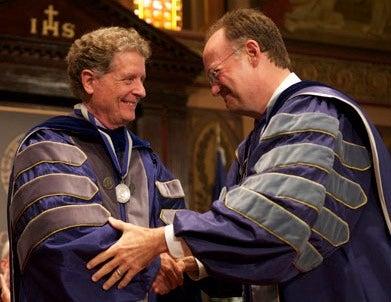 Richard Schlegel and Jack DeGioia shake hands