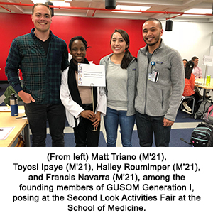 (From left) Matt Triano (M'21), Toyosi Ipaye (M'21), Hailey Roumimper (M'21), and Francis Navarra (M'21), among the founding members of GUSOM Generation I, posing at the Second Look Activities Fair at the School of Medicine.