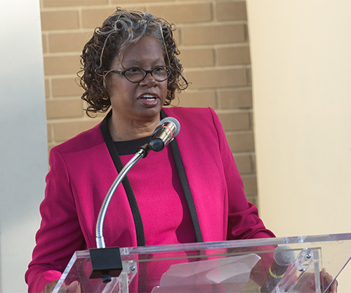 Dr. Lucille Adams-Campbell speaks at a podium