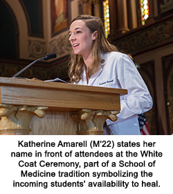 Katherine Amarell (M'22) states her name in front of attendees at the White Coat Ceremony, part of a School of Medicine tradition symbolizing the incoming students' availability to heal.