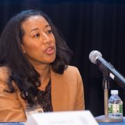 Dr. Ana Caskin speaks into a microphone