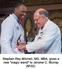 """Stephen Ray Mitchell, MD, MBA, gives a new """"magic wand"""" to Jerome C. Murray (M'22)."""
