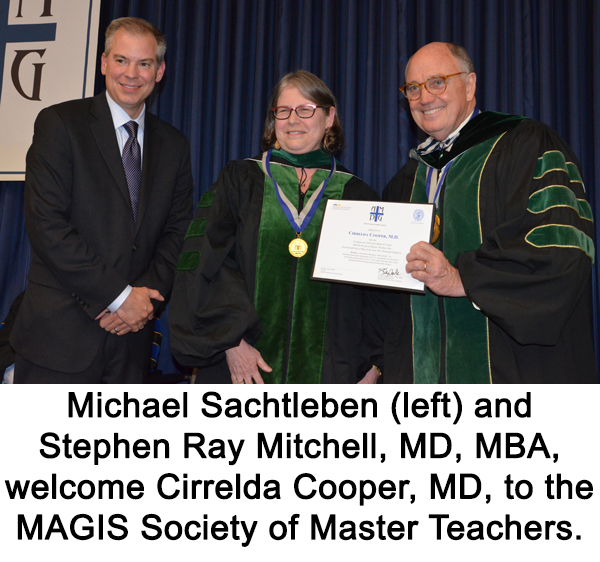 Michael Sachtleben (left) and Stephen Ray Mitchell (right) stand with Cirrelda Cooper (center) at the MAGIS Society of Master Teachers.