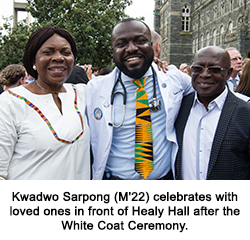 Kwadwo Sarpong (M'22) celebrates with loved ones in front of Healy Hall after the White Coat Ceremony.
