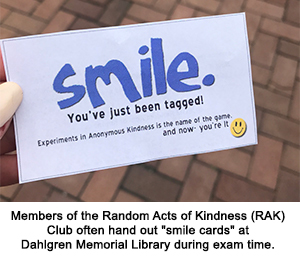 """Members of the Random Acts of Kindness (RAK) Club often hand out """"smile cards"""" at Dahlgren Memorial Library during exam time."""