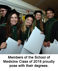 Members of the School of Medicine Class of 2018 proudly pose with their degrees.