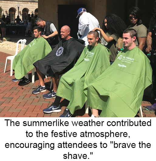 St. Baldrick's participants sit in plastic chairs draped in protective covers awaiting their shaves