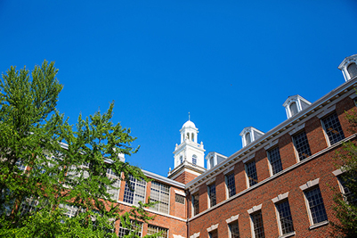 Med-Dent building picturing the cupola against a blue sky