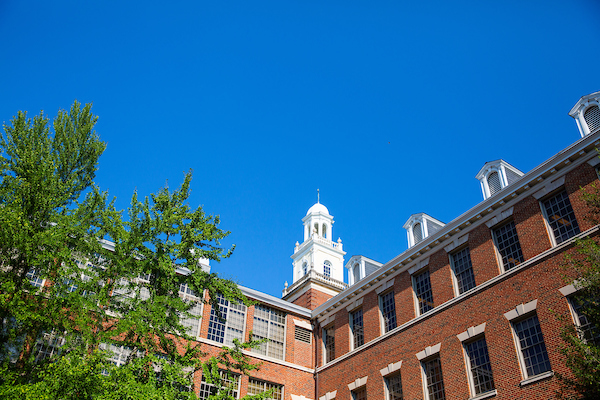 Exterior of the Med-Dent Building showing the building cupola against a brilliant blue sky