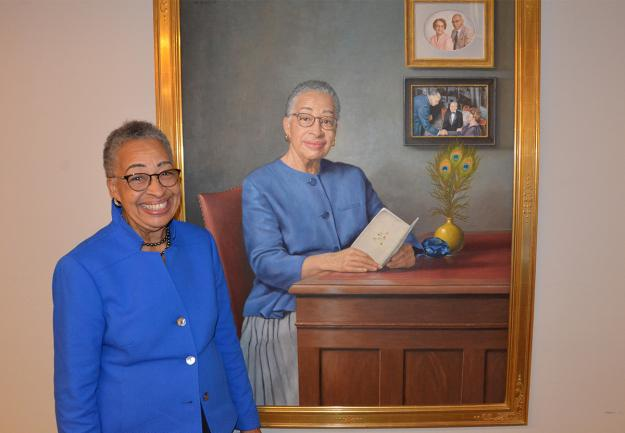 Former Dean Joy Phinizy Williams poses in front of her portrait, painted by James Crowley and sponsored by the Office of the Dean of Medical Education, on October 25 during a dedication and unveiling ceremony at Georgetown University School of Medicine (GUSOM).