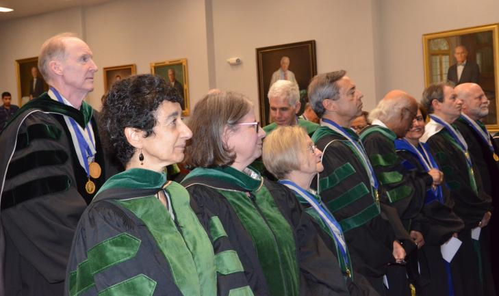 Members of the MAGIS Society of Master Teachers welcome two new inductees in a May 17 ceremony at the Gorman Auditorium at MedStar Georgetown University Hospital.