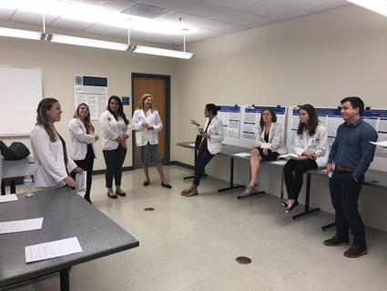 Medical students prepare to present their posters during Student Research Day 2018.