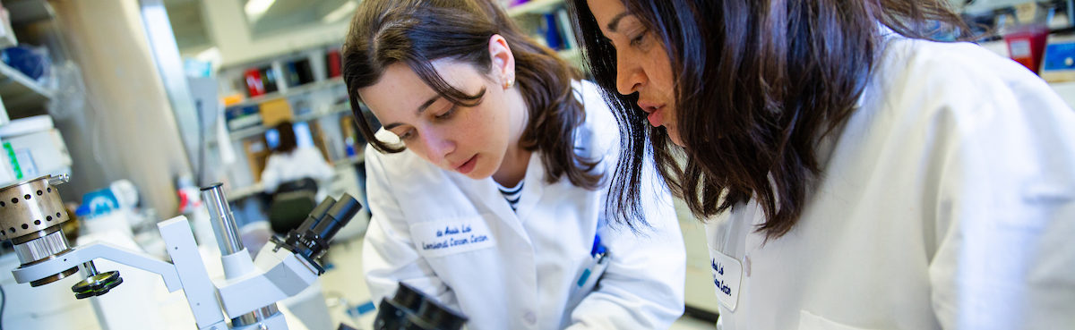 A student and professor work together in a lab setting