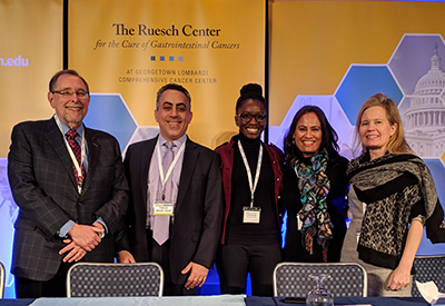 Panelists in a discussion on innovation and challenges in clinical research stand side by side for a group photo