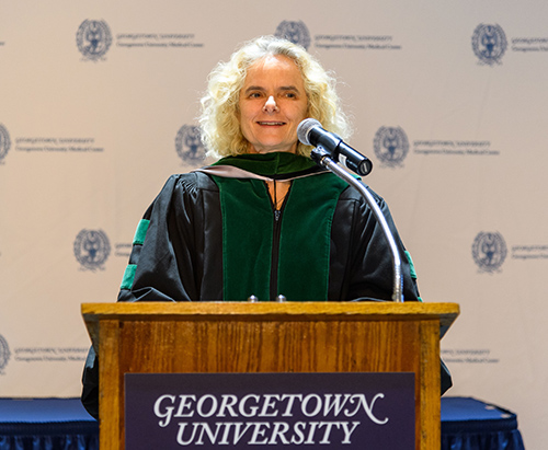 Nora Volkow, MD, speaks at a podium