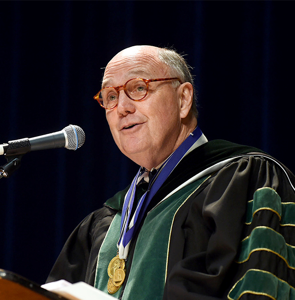 Dr. Mitchell speaks at a podium