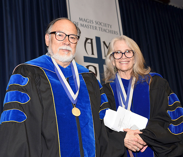 Adam Myers and Susan Mulroney stand side by side in academic regalia