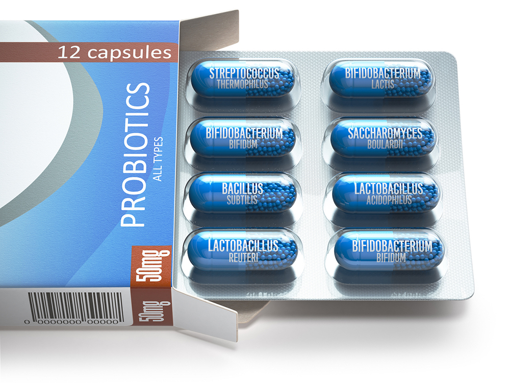 "A box labeled ""probiotics"" is partially open displaying capsules"