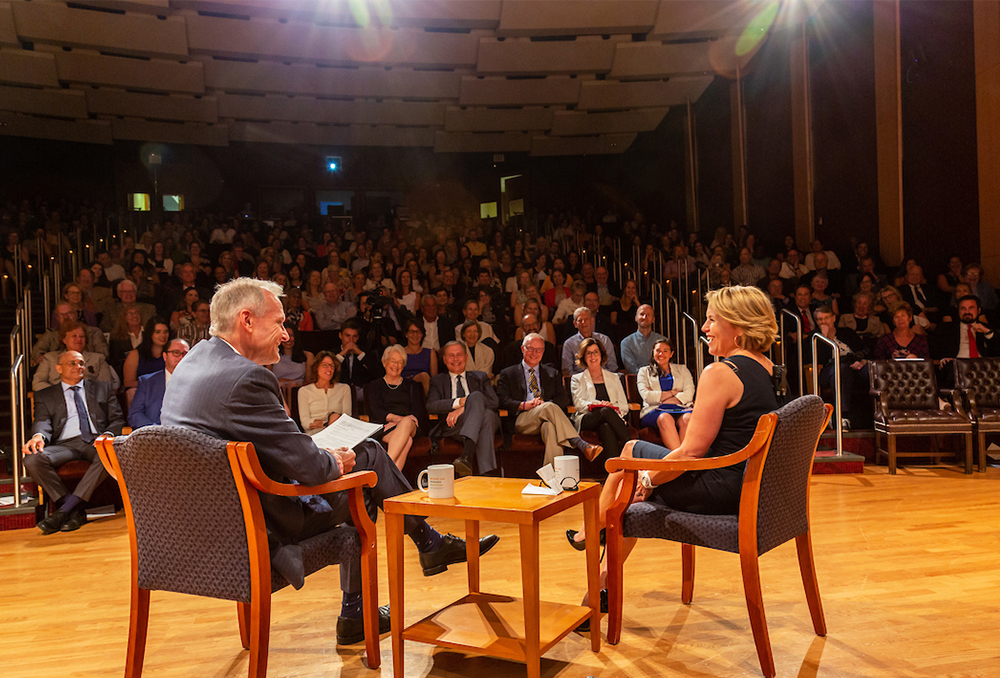 Dr. Marshall and Katie Couric sit in chairs onstage