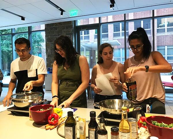 Four students prepare food