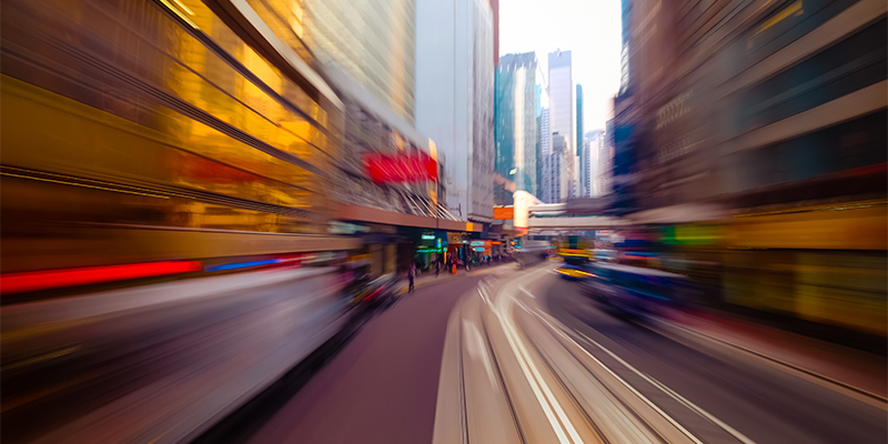 Blurred image of a city street implies motion