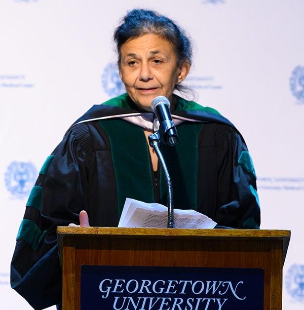Wafaa El-Sadr speaks at a podium