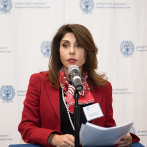 Dr. Golestaneh speaks into a microphone