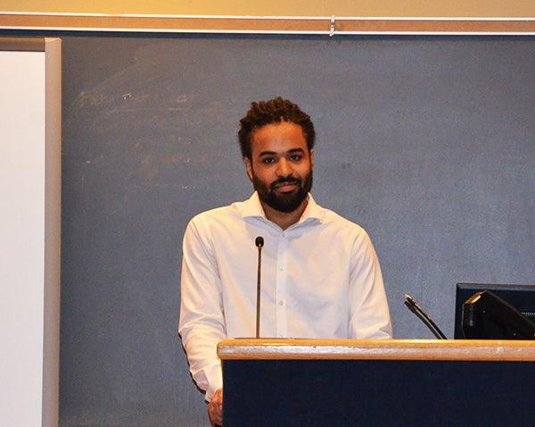 A man stands at a podium