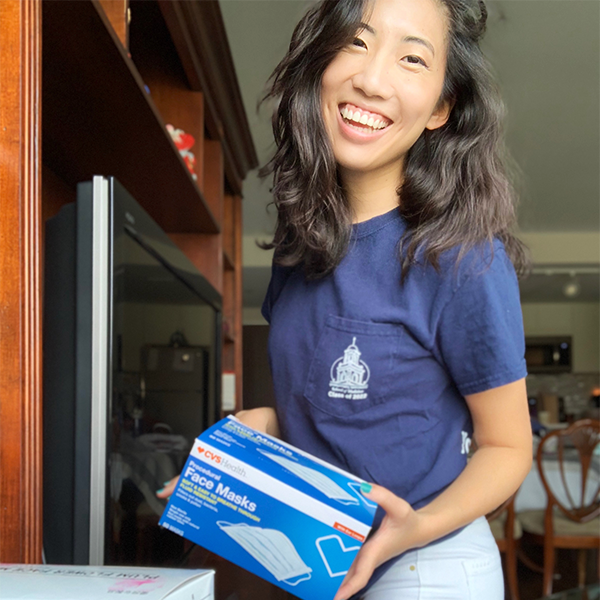 Cynthia Pham holds a box of medical supplies