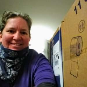 Heidi Gauthier, director of N. Street Village, with her care package from Hoya Clinic