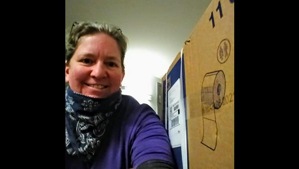 Heidi Gauthier with cardboard box