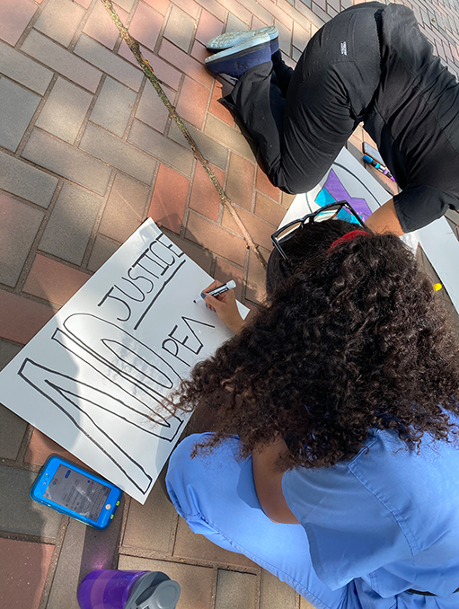 Medical students creating signs for the March on Washington