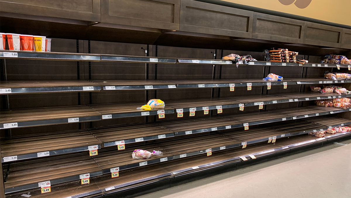 Shelves for bread are mostly empty in a grocery store