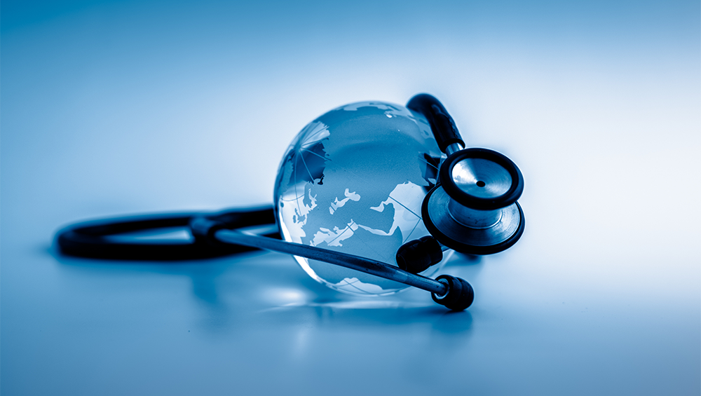 Photo illustration of a globe wrapped with a stethoscope