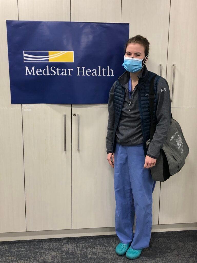 Elizabeth Zolper stands next to a MedStar Health banner