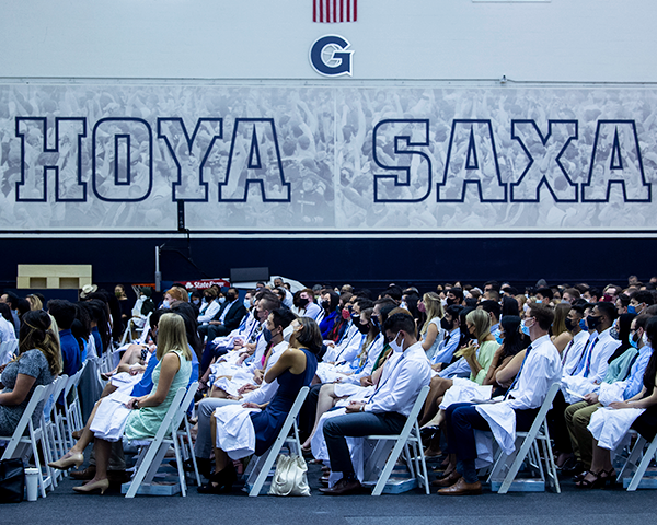School of Medicine students sit in rows of chairs during the White Coat ceremony