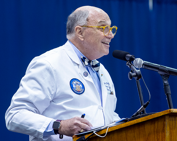 Dr. Mitchell addresses White Coat ceremony attendees from a podium