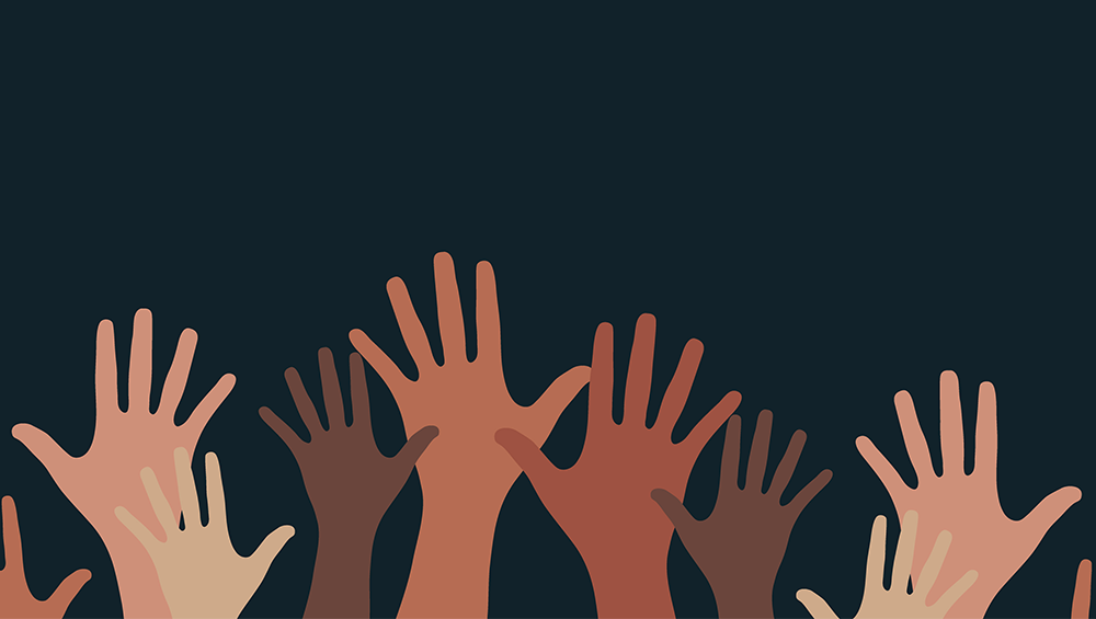 An illustration of hands depicting many races raised in solidarity