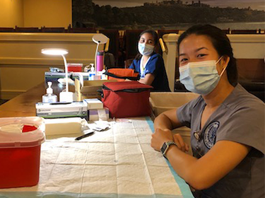 Medical personnel sit at a table