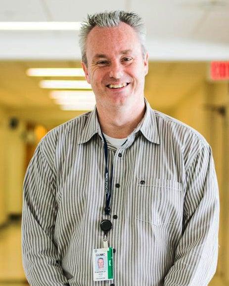 James Granlund, Jr. stands in a hallway at Georgetown